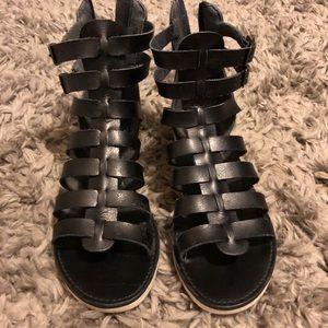 Black gladiator sandals, size 7.5
